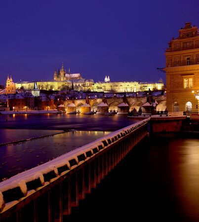 Lavka and Prague Castle with Charles bridge in winter, Prague, Czech Republic photo
