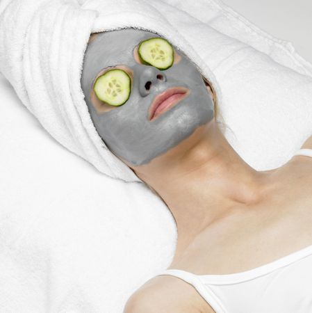 woman with facial mask photo