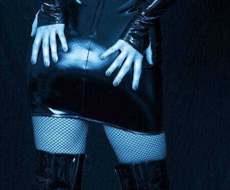 extravagancy: detail of woman in latex