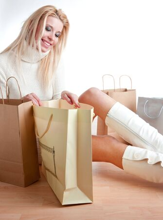 shopping woman sitting on the floor photo