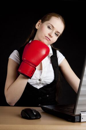 businesswoman with a notebook and boxing glove photo