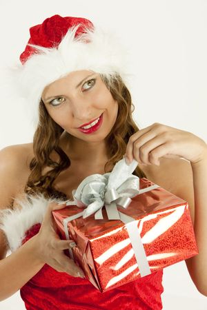 portrait of female Santa Claus with Christmas present photo