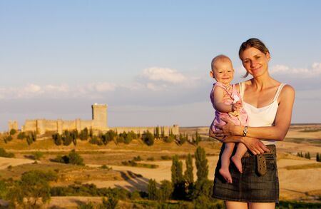 castile leon: mother with her baby girl, Penaranda de Duero Castle, Burgos Province, Castile and Leon, Spain
