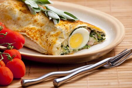 puff roly-poly filled with spinach and eggs photo