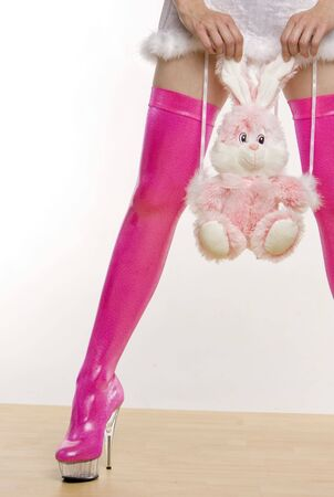 extravagancy: extravagant pink boots and hands holding a rabbit toy