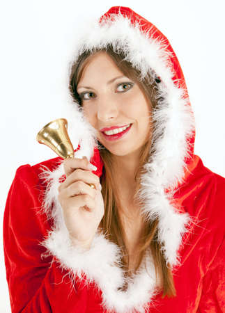 portrait of female Santa Claus with a bell photo