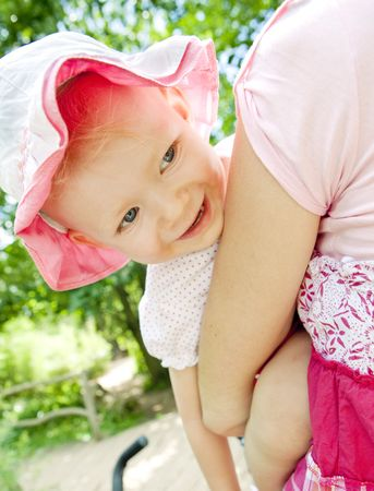 portrait of little girl hugging by her mother Stock Photo - 6306646