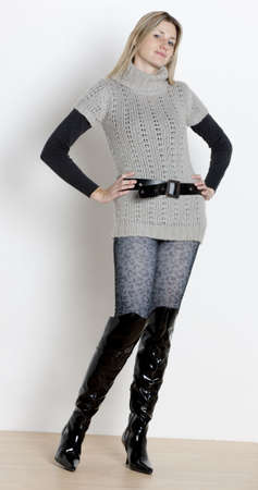 pullovers: standing woman wearing fashionable boots