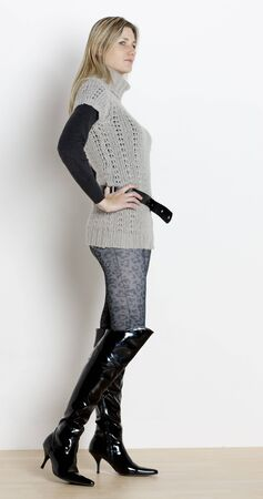 leggings: standing woman wearing fashionable boots