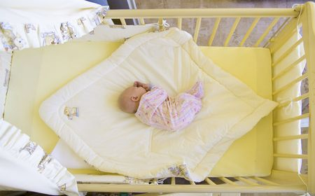 defenseless: baby in cot