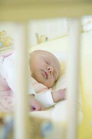 defenceless: baby in cot