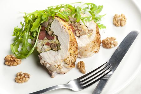 ruccola: pork roll filled with sausages, eggs, almonds and ruccola