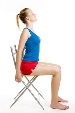 ejercicio de mujer sentada en silla Foto de archivo
