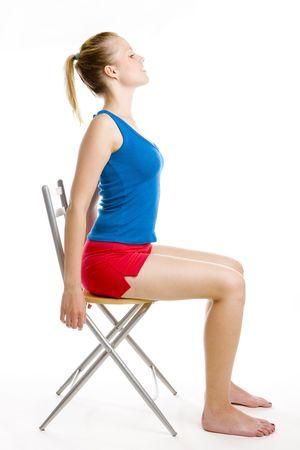 exerçant la femme assise sur chaise  Banque d'images