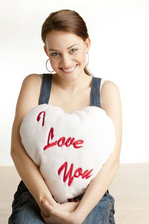 portrait of woman holding a heart photo