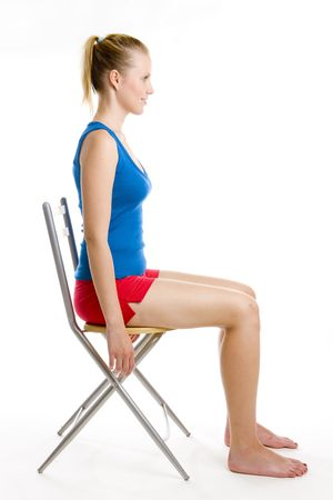 exercising woman sitting on chair photo