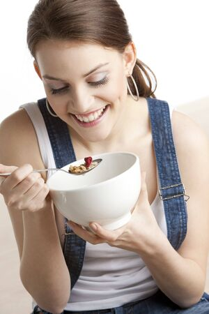 portrait of woman eating cereals Stock Photo - 6156080