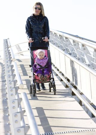 woman with toddler sitting in pram on walk Stock Photo - 6306649