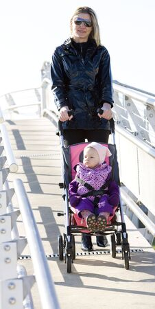 woman with toddler sitting in pram on walk Stock Photo - 6306721