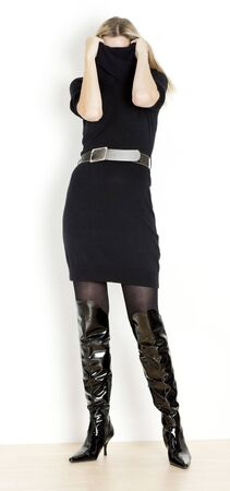 standing woman wearing black dress and fashionable boots Stock Photo - 6306701