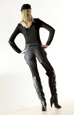 standing woman wearing fashionable boots photo