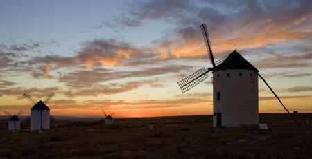 windmills at sunset, Campo de Criptana, Castile-La Mancha, Spain Stock Photo - 6313529