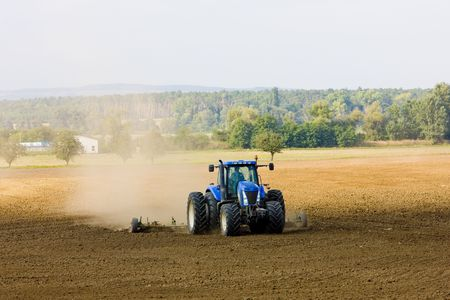 agricultural implements: tractor on field, Czech Republic