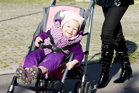 woman with toddler sitting in pram on walk Stock Photo - 6513790