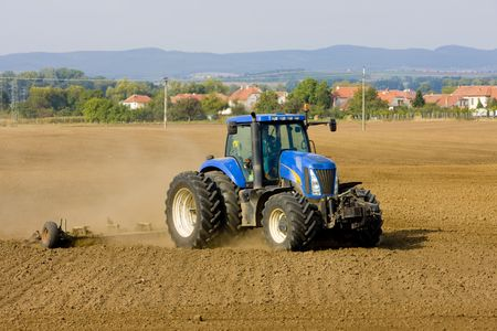implements: tractor on field, Czech Republic