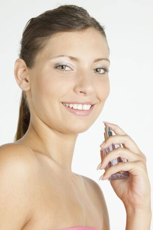 portrait of young woman with perfume photo