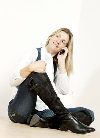 sitting woman with mobile phone photo