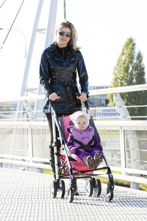 woman with toddler sitting in pram on walk Stock Photo - 6816275