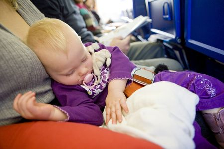 defenseless: toddler girl sleeping on plane