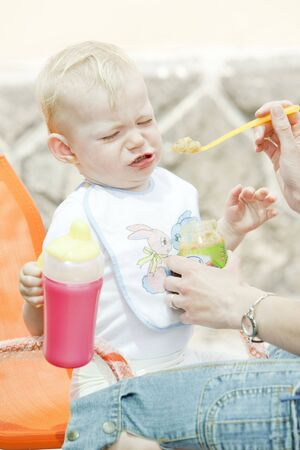 mammas: portrait of eating little girl
