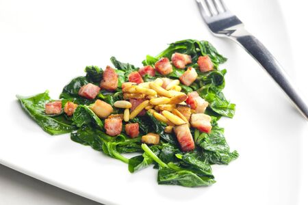 pine kernels: fried spinach with bacon and pine nuts