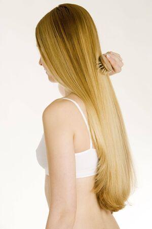 long haired: combing woman wearing underwear