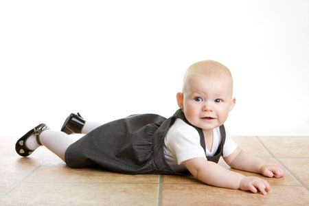 defenceless: lying down baby Stock Photo