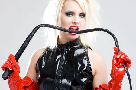 extravagancy: woman in latex with whip Stock Photo