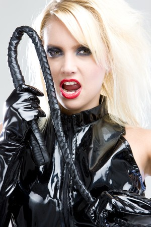 tough: woman in latex with whip Stock Photo