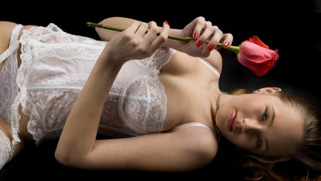 portrait of lying down woman with rose photo