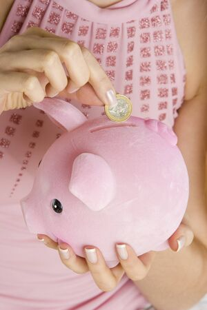 detail of woman with a piggy bank Stock Photo - 6879517