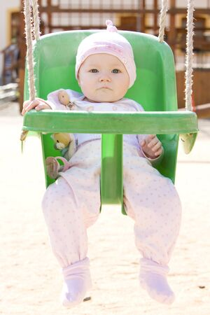 baby sitting on swing Stock Photo - 6909468