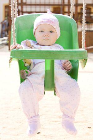 baby sitting on swing Stock Photo - 6909468