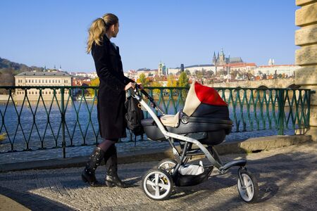 woman with a pram in Prague, Czech Republic photo
