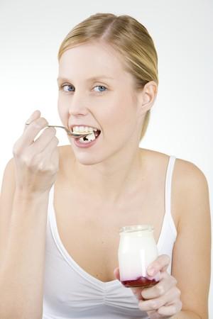 woman eating yogurt photo