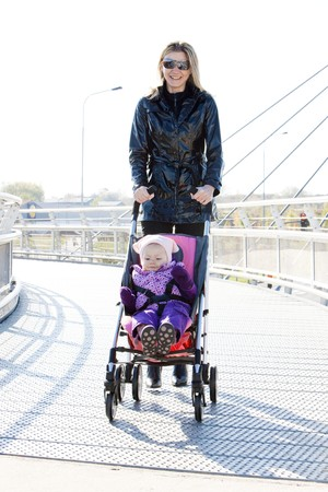 woman with toddler sitting in pram on walk Stock Photo - 7163018