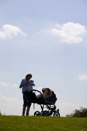 woman with baby and pram Stock Photo - 7162167