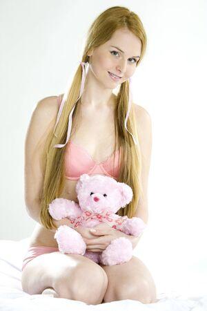 kneel down: woman wearing underwear with teddy bear
