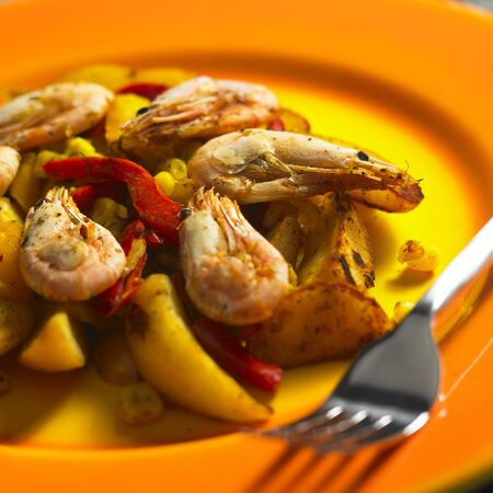 alimentation: vegetables mixture with prawns and potatoes