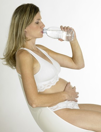 mammas: pregnat woman with a bottle of  water